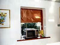 Roman blind in recessed window frame.
