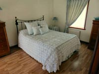 Curtain, cushions, bedspread and bed valance.