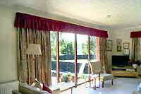 Patterned curtains with matching gathered valance.