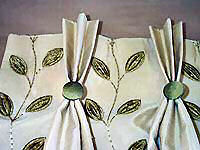 Pich pleat curtains with buttons.