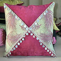 Square cushion cover with contrast fabric and shell trim.
